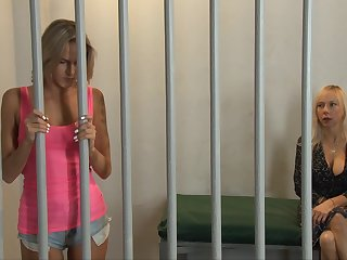 Emma Hix and Mirabella Amore lick every time other in a prison chamber