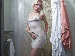 Mature blonde Artemia is toying her old snatch in eradicate affect shower