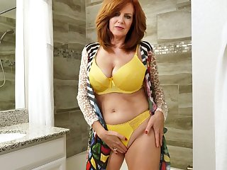 Red haired mature woman Andi James is taking a shower with the addition of masturbating pussy