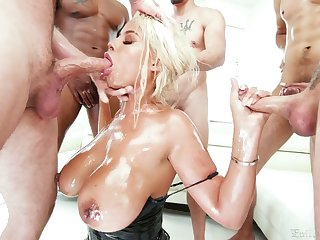 Surrounded by numerous amount of studs Bridgette B sucks all the fat cocks